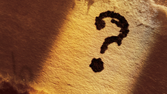 Question mark on parchment paper